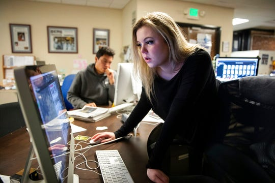 This Oct. 29, 2019 photo shows Editor-in-Chief Maddy Arrowood, a senior journalism and American history major, checking pages of The Daily Tar Heel, the independent student newspaper of the University of North Carolina at the paper's editorial office in Chapel Hill, N.C.