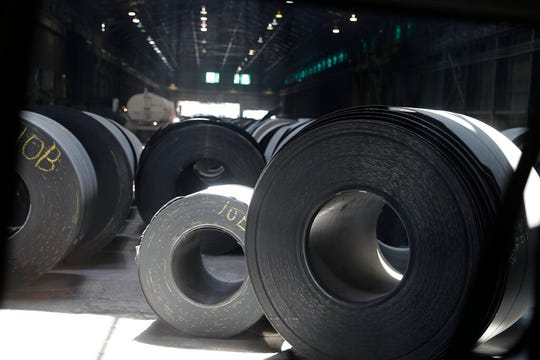In this June 28, 2018, file photo, rolls of finished steel are seen at the U.S. Steel Granite City Works facility in Granite City, Ill.