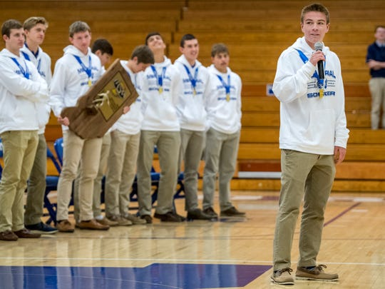 Memorial's Isaac Bennett, right, gives a speech as the school celebrates the soccer team's 2A state championship win during an assembly inside Robert M. Kent Athletic Center at Memorial High School in Evansville, Monday morning, Nov. 4, 2019.