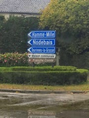 A road sign in the Walloon region of Belgium points the way to Hamme-Mille, the home of Curly Lambeau's paternal grandparents.