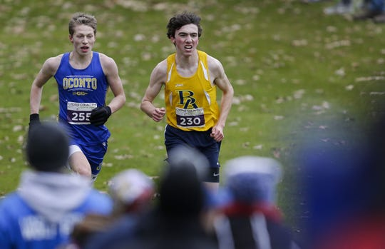 Oconto High School's Josh Woller (255) runs even with Brookfield Academy's Nathaniel Osborne (230) as they enter the homestretch during the WIAA Division 3 state cross country meet on Saturday, Nov. 2 at The Ridges Golf Course in Wisconsin Rapids.
