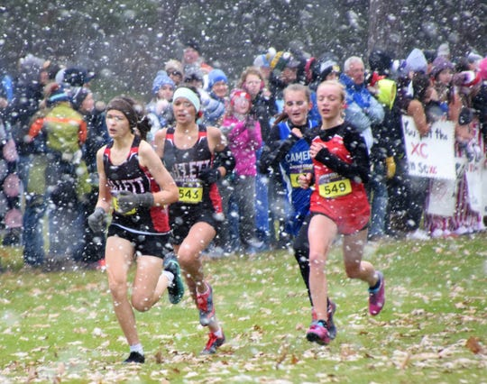 Angela Mosconi and Cheyenne Wagner of Gillett run through the snow and wind in the Division 3 state cross country meet held at the Ridges Golf Course in Wisconsin Rapids on Saturday, Nov. 2.