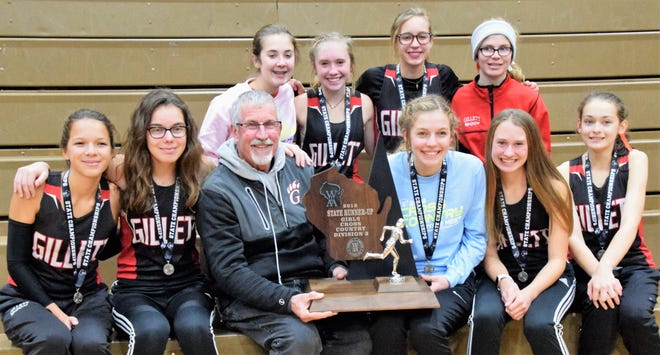 The Gillett girls cross country team poses with their runner-up trophy at from the state meet on Saturday, Nov. 2 in Wisconsin Rapids. From left, back row: Macy Franti, Ryann Wagner, Alaina Herzog, Laney DeBauch; front row: Cheyenne Krueger, Kasey Hanse, Coach Bill DeJung, Sylvia Hansen, Megan Wagner and Angela Mosconi.