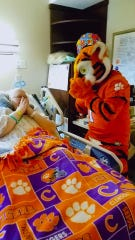 Angie Grice gets a visit from the Clemson Tigers mascot during her three months in the hospital.
