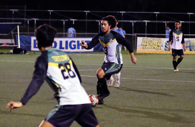 UOG Tritons Isaiah Macias drives to the goal during a Nov. 2 match-up against the Sidekicks Soccer Club.