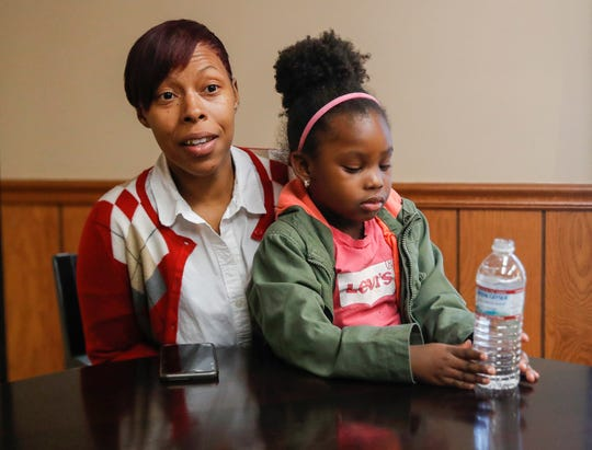 Mariaa Roberson sits with her daughter, Beautiful Roberson, at St. Mary's Childcare Center, Wednesday, Oct., 30, 2019, Indianapolis. Beautiful is the third of her children to attend St. Mary's, a nonprofit providing child care and education to Indianapolis-area children ages 3-5.