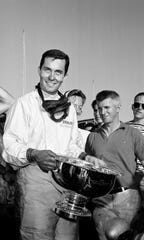 Roger Penske of Gladwyne, Pa., holds the Commonwealth Trophy after winning the Grand Prix of Puerto Rico at the Antilles Auto Racing Circuit in Caguas, Puerto Rico, Nov. 11, 1962. Penske drove a Cooper Special setting a new track record, completing the 17-mile circuit in 1.17.6.)