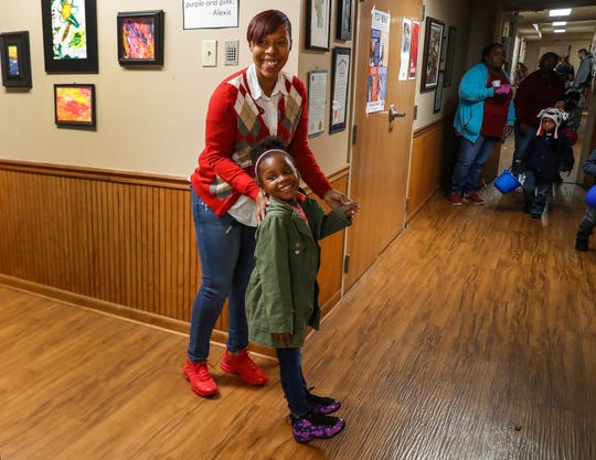 Mariaa Roberson stands in the hallway with her daughter, Beautiful Roberson, at St. Mary's Childcare Center, Wednesday, Oct., 30, 2019, Indianapolis. Beautiful is the third of her children to attend St. Mary's, a nonprofit providing child care and education to Indianapolis-area children ages 3-5.