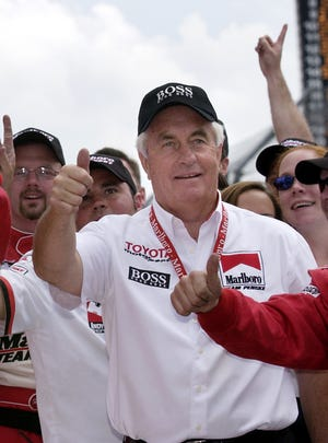 Team owner Roger Penske joins in the celebration in victory circle after his drives Gil de Ferran won the Indianapolis 500 on May 25, 2003.
