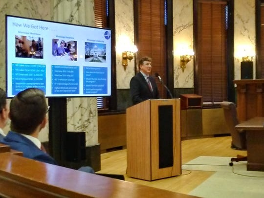 Richard Roberson, general counsel and vice president for Policy and State Advocacy for the Mississippi Hospital Association, presents a proposal for Medicaid expansion to the Joint Mississippi House and Senate Democratic Legislative Caucus on Oct. 22, 2019, that he said would cost the state nothing and result in a healthier, more productive workforce.