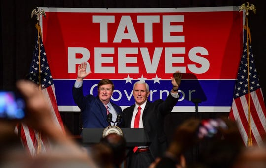 Mississippi gubernatorial candidate Tate Reeves raises his hands with Vice President Mike Pence during his rally at the Mississippi Gulf Coast Convention Center Monday, Nov. 4, 2019,  in Biloxi, Miss.