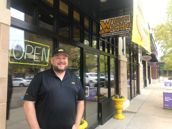 Mike McIntyre, owner of Which Wich? Superior Sandwiches, poses outside his newly reopened restaurant at 145 Market Street in Flowood on Monday, Oct. 28, 2019.