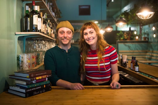 Owners of The Tern Club Ryan Shanley and Jocelyn Morin pose for a photo behind the bar.