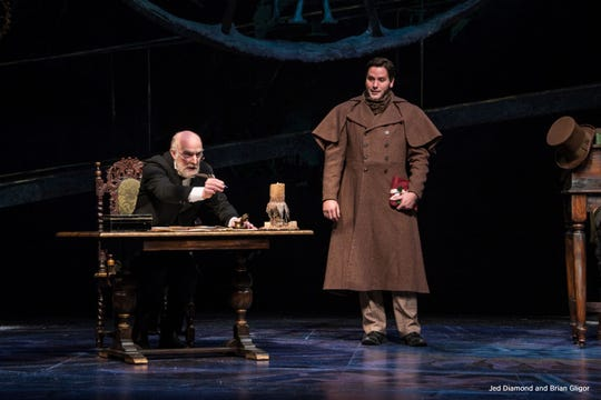 "Jed Diamond and Brian Gilgor are Ebenezer Scrooge and his nephew Fred in the Clarence Brown Theatre's ""A Christmas Carol."""