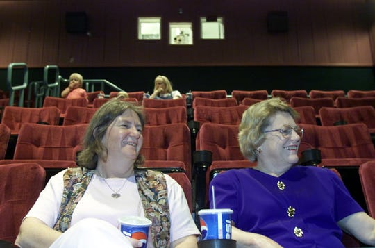 Patti O'Callaghan, left, and West Lafayette mayor Sonya Margerum wait for the show to begin during the opening night at the Wabash Landing 9 theaters in West Lafayette on May 24, 2000. Both were taking in the hit movie Dinosaurs. O'Callaghan is a councilman in the city.