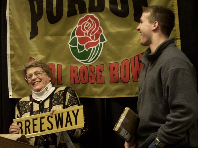 Wabash Landing's surface parking lot is actually a city street called Brees Way, named for former Purdue quarterback Drew Brees in December 2000. Here Brees shares a laugh with then West Lafayette Mayor Sonya Margerum at the street naming ceremony.