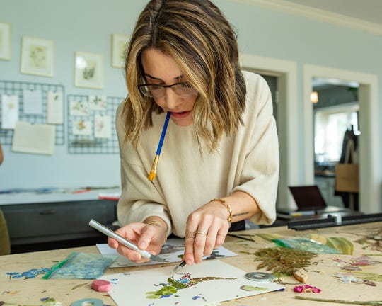 What started as an side hobby to create wall decor has turned into Preservation Press, a local plant pressing business, offering one-of-a-kind wall and home decor.Hannah Castille works on her new project, a nursery line, for the company. Tuesday, Oct. 29, 2019.