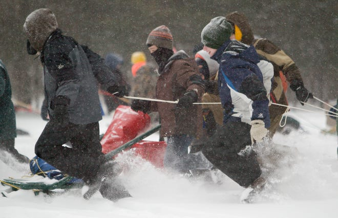 Boy Scouts and Cub Scouts launch into a day of winter-related camping events at Camp Munhacke in Lyndon Township Saturday, Jan. 17, 2009. Camp Munhacke will close on Dec. 31, 2019 after 68 years in operation.