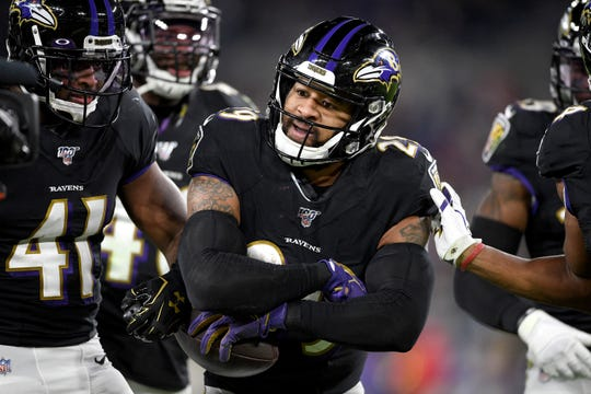 Baltimore Ravens safety Earl Thomas III reacts after intercepting a pass from New England Patriots quarterback Tom Brady during the second half of an NFL football game, Sunday, Nov. 3, 2019, in Baltimore. (AP Photo/Nick Wass)