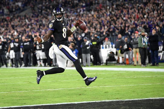 Baltimore Ravens quarterback Lamar Jackson scores a touchdown on a run against the New England Patriots during the first half of an NFL football game, Sunday, Nov. 3, 2019, in Baltimore. (AP Photo/Nick Wass)