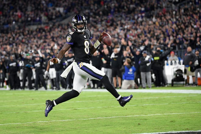 Ravens quarterback Lamar Jackson scores a rushing touchdown against the Patriots in a November 2019 game in Baltimore.
