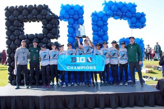 Michigan State's women's cross country team celebrates its Big Ten championship Sunday in Columbus, Ohio.