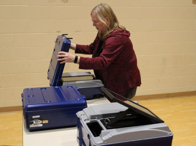 Cindy Price, director of the Marion County Board of Elections, sets up a voting machine on Monday at Dayspring Wesleyan Church. Polling places across the county will be open from 6:30 a.m. to 7:30 p.m. Tuesday for residents to vote in the general election. For information about elections in Marion County, visit marionelections.com.