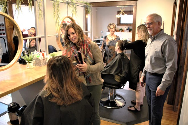 Visible Changes Salon owner Tim Sullivan, right, watches as stylist Kailee Beechum takes care of a customer at the salon. In the background, salon manager Carolyn Walters, left, talks with stylist Natali Lavery as she serves another customer. Visible Changes Salon is located at 588 Delaware Avenue in Marion. It opened at its new location on Sept. 3.