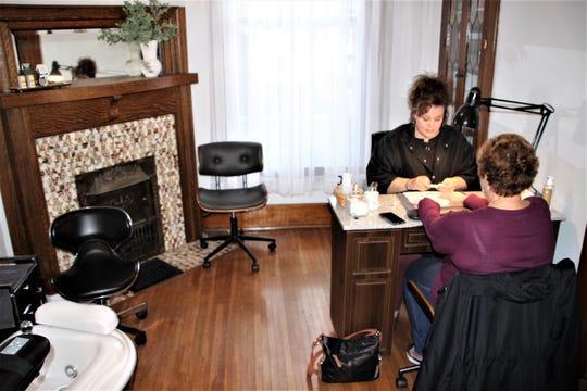 Nail tech Tonya Tackett serves a customer in an inviting space at the new home of Visible Changes Salon at 588 Delaware Avenue, Marion.