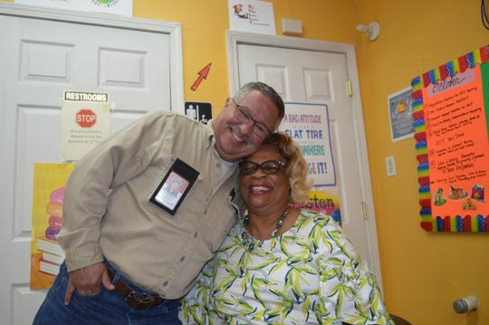 Ruth Rawlings Banks, CEO of Feed the Needy, and Steve Freeman, its chief operating officer, hug at an organizational meeting. This Thanksgiving will mark the 25th year the organization has been delivering food baskets to needy Shelby County families.