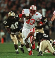Ron Dayne bursts through big hole in the third quarter against Purdue, Saturday, November 6, 1999 in West Lafayette, Indiana. The Badgers beat the Boilermakers 28-21 and Ron Dayne ran 221 yards including a 41 yard touchdown run to win.