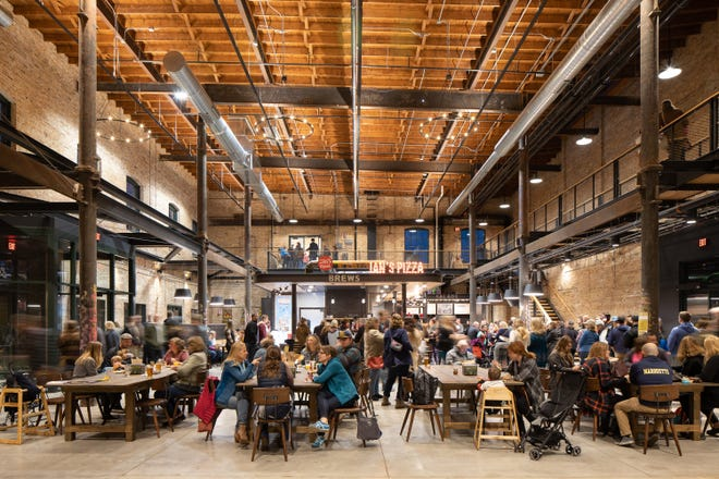 Ian's Pizza anchors the central hall at Madison's Garver Feed Mill, which opened in a refurbished century-old sugar beet factory in 2019.