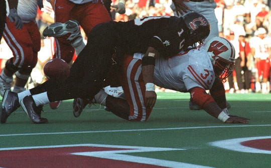 Ron Dayne fumbles in the end zone and Cincinnati's Jeff Burrow recovers for the Bearcats in 1999.