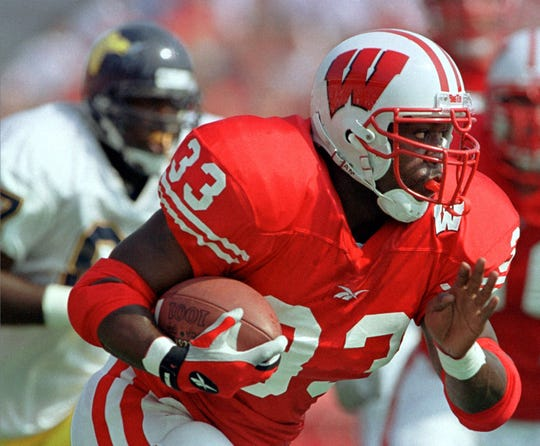 Wisconsin's running back Ron Dayne breaks away for a long gain in the first half against Murray State Saturday, Sept. 4, 1999, in Madison, Wis. Dayne rushed for 135 yards and scored three touchdowns as Wisconsin won 49-10.