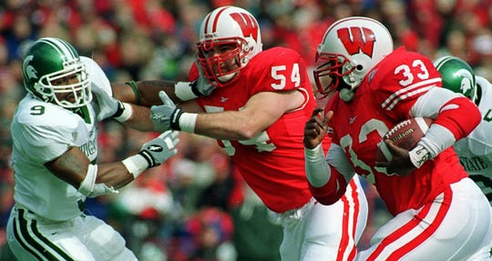 Following a block thrown by Wisconsin right guard Dave Costa Jr. on Michigan State's Aric Morris, running back Ron Dayne has some running room during their game Saturday, October 23, 1999 at Camp Randall Stadium in Madison, Wis.