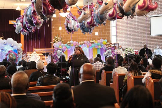 "Pastor Carol Polk, center, delivers the eulogy at the funeral of sisters A'Lisa ""Lisa"" Z. Gee, 6, and Amea N. Gee, 4 who were struck and killed by a hit-and-run driver while crossing the street.  The funeral was held at Jerusalem Missionary Baptist Church in Milwaukee."