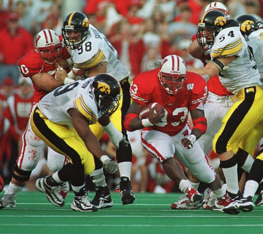 Ron Dayne runs for a record 37 yard run, setting an NCCA rushing record in the second quarter against Iowa on November 13, 1999.