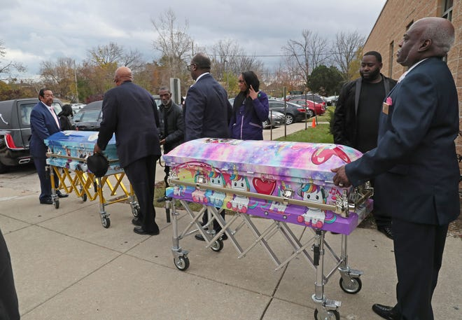 "Unicorn- and ""Frozen""-themed caskets of sisters A'Lisa ""Lisa"" Z. Gee, 6, and Amea N. Gee, 4, who were struck and killed by a hit-and-run driver while crossing the street were placed in the hearse after their funeral service Monday. The funeral was held at Jerusalem Missionary Baptist Church in Milwaukee. Their cousin Drevyze Rayford was also seriously injured in the accident."