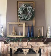 Debbie Czarnecki of Muskego adds a modern twist to traditional with empty frames to break up silver and blue accessories.