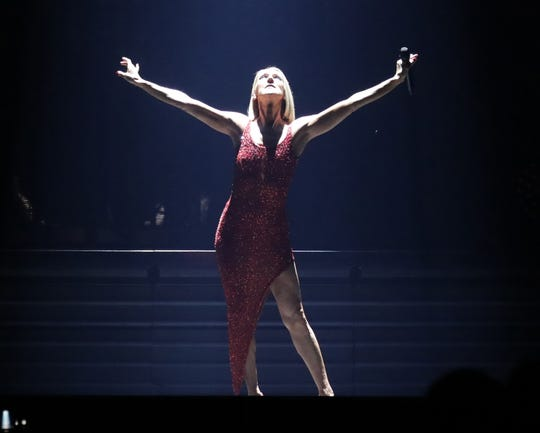 "Celine Dion performs her song ""It's All Coming Back to Me Now"" during her concert at Fiserv Forum in Milwaukee."