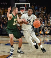 Marquette guard Koby McEwen likes to attack opposing defenses.