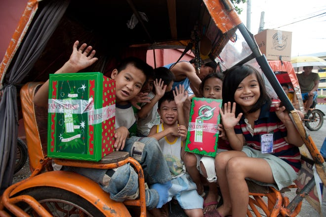 Shoeboxes from Operation Christmas Child are delivered via card to children in the Philippines.