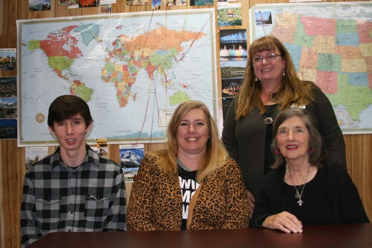 Lucas Sutton (left) of Salesville recently completed all 10 levels of the Barton Reading System with the assistance of the Twin Lake Literacy Council (TLLC). Also pictured are: (from left) Mandy Sutton, his mother; Anna Marie Eiteniller, Sutton's volunteer tutor; and Heather Powell (standing), executive director of the TLLC.