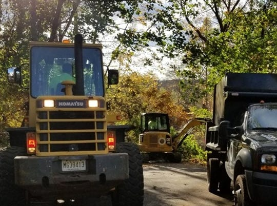 Heavy equipment is rolled out to clear trees from roads and properties in Madison after an EF-1 tornado touched down in the borough early Saturday morning, Nov. 2