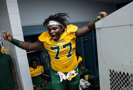 Carver's James Robinson (77) pumps up his team in the locker room at Cramton Bowl in Montgomery, Ala., on Thursday, Sept. 26, 2019. Lee leads Carver 28-7 at halftime.