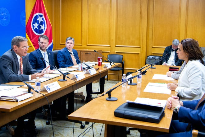 Gov. Bill Lee, left, asks questions to Department of Human Services Commissioner Danielle Barnes, right, during the budget hearing at the Tennessee State Capitol on Nov. 4.