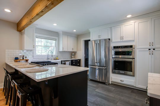 Also added to the home at 1502 Figuers during renovation is a large wood beam and modern kitchen with stainless appliances, a farmhouse sink and subway tiles that is open to the living space.