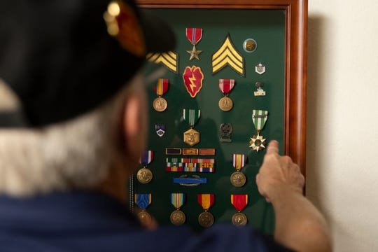 Gary Bonvillian talks about his military medals, ribbons and awards, Monday, Nov. 4, 2019, at his home in Estero.