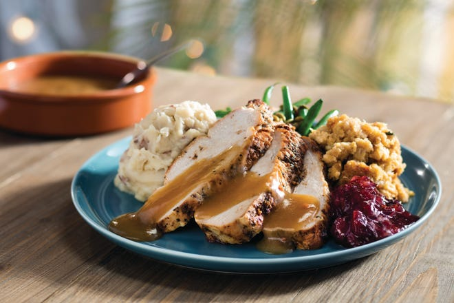 Sliced turkey with sides like callaloo, green beans, cornbread stuffing and cranberry-pineapple chutney, starting at $19.99, at Bahama Breeze on Thanksgiving.