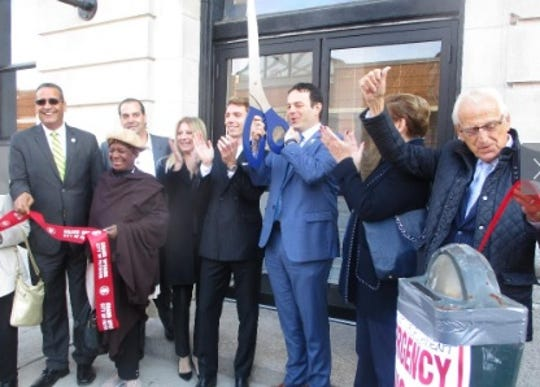 Mayor Andre Sayegh cuts a ribbon for the renovated former Paterson Police Headquarters at 111 Washington Street on Nov. 4, 2019.